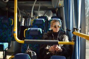 Girl with headphones on bus