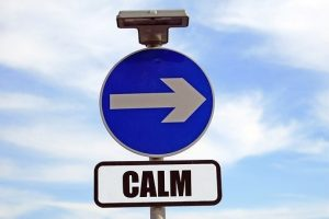 A sign that says calm