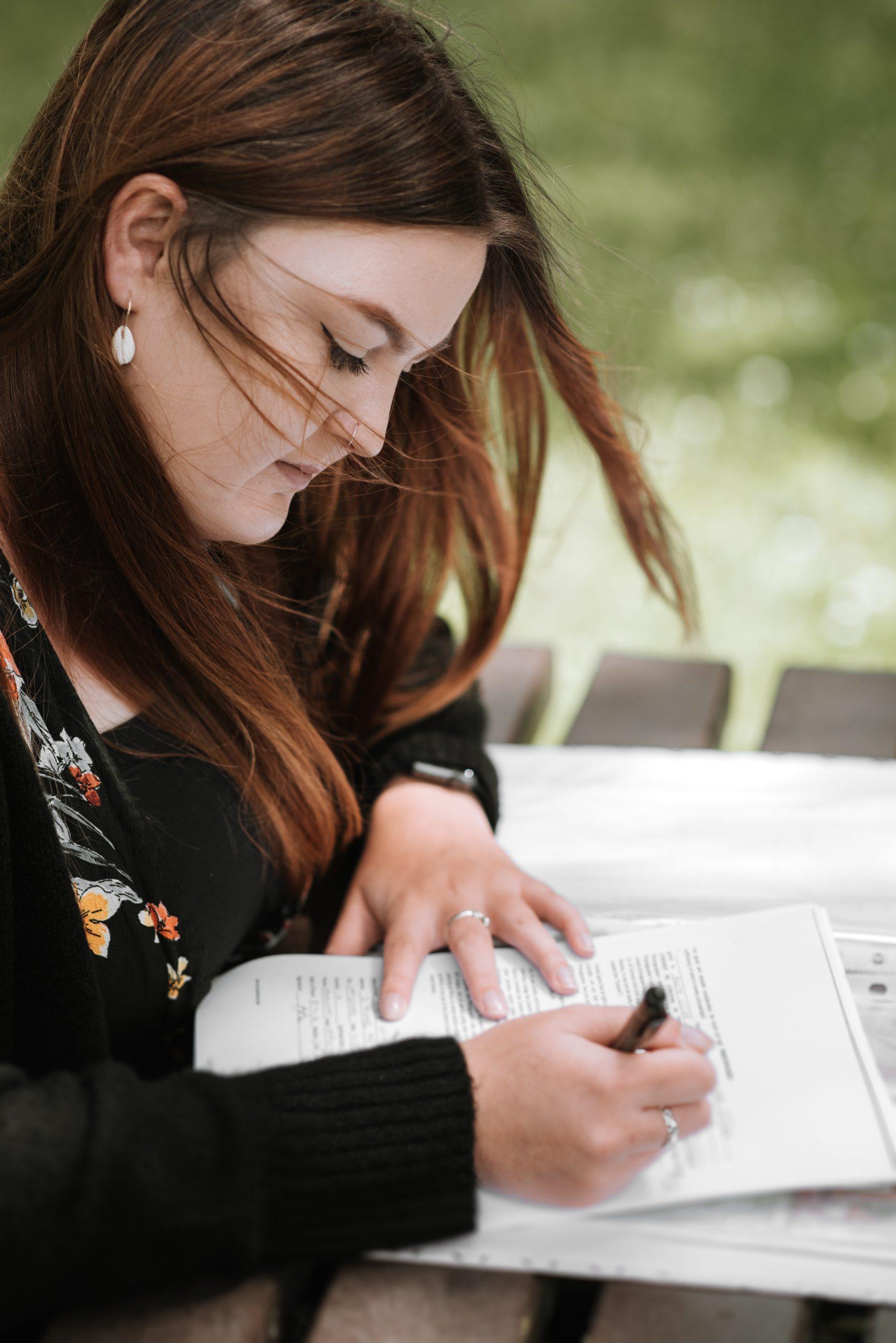 Woman writing an essay