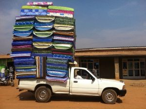 Ute crammed with mattresses
