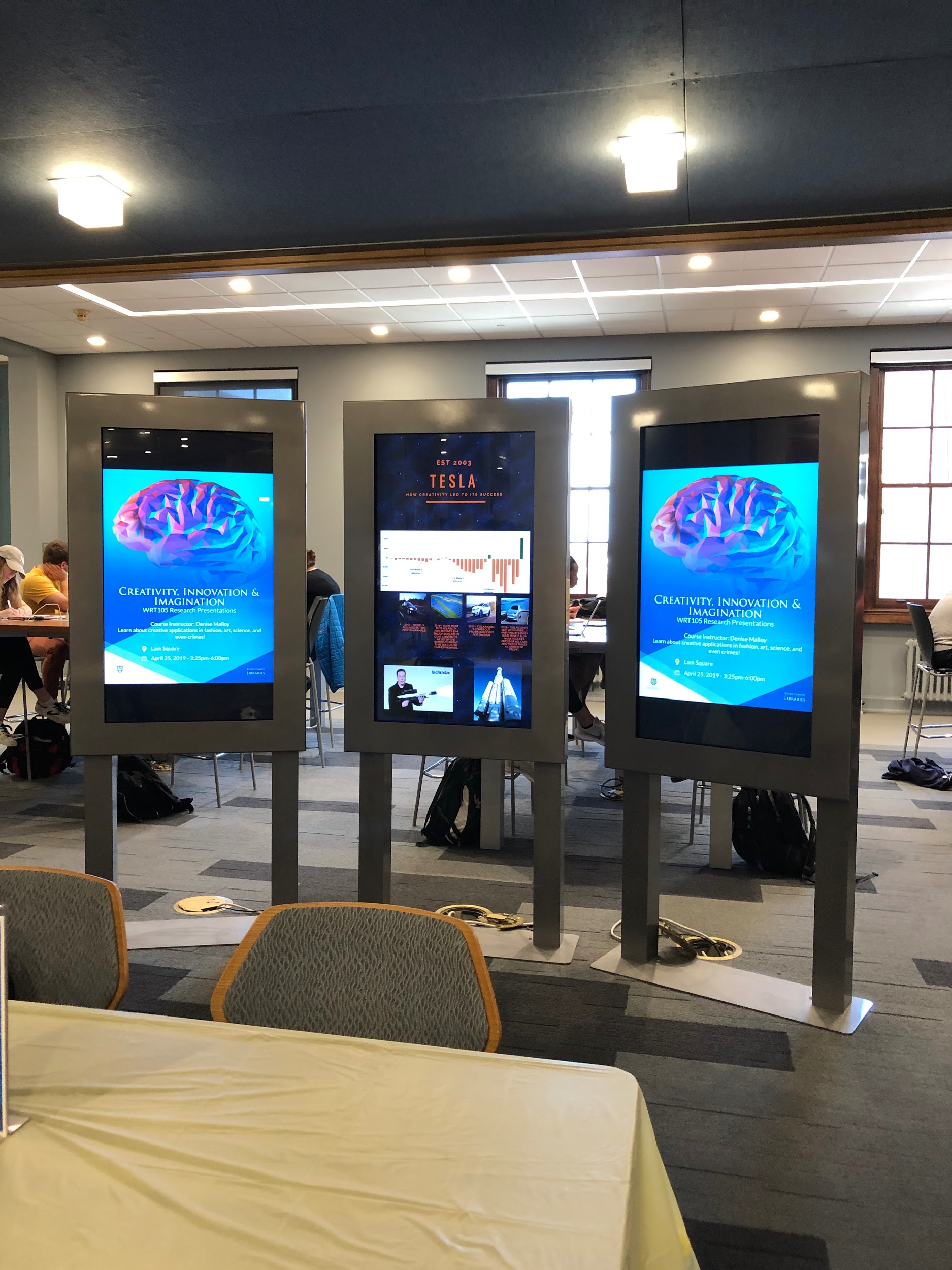 three digital display signs outside the pop up session